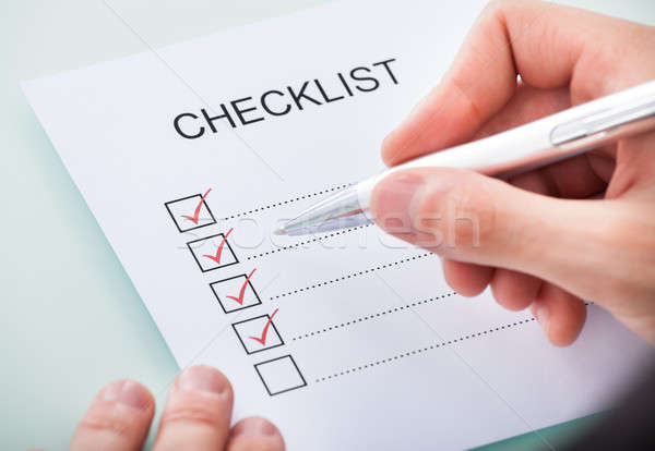 Person's Hand Marking On Checklist With Pen Stock photo © AndreyPopov