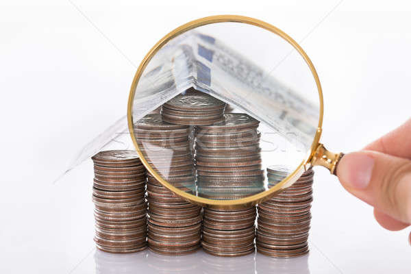 Inspecting house made from coins Stock photo © AndreyPopov