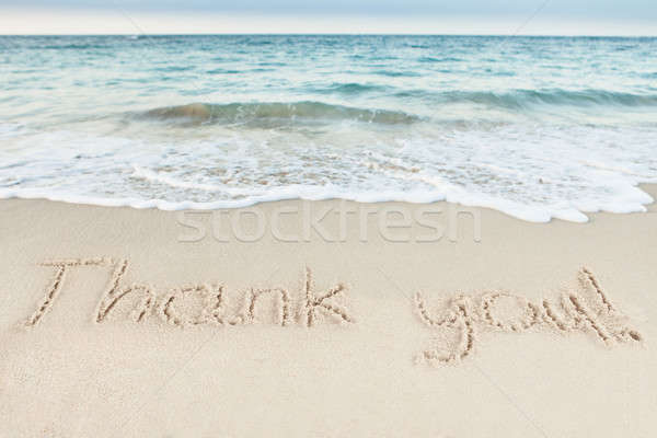 Thank You Written On Sand By Sea Stock photo © AndreyPopov
