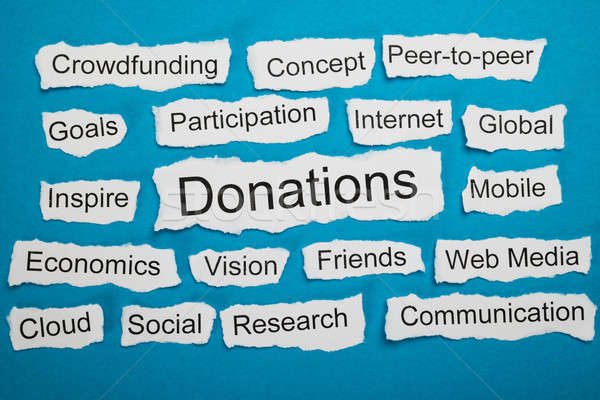 Word Donations On Piece Of Torn Paper Stock photo © AndreyPopov