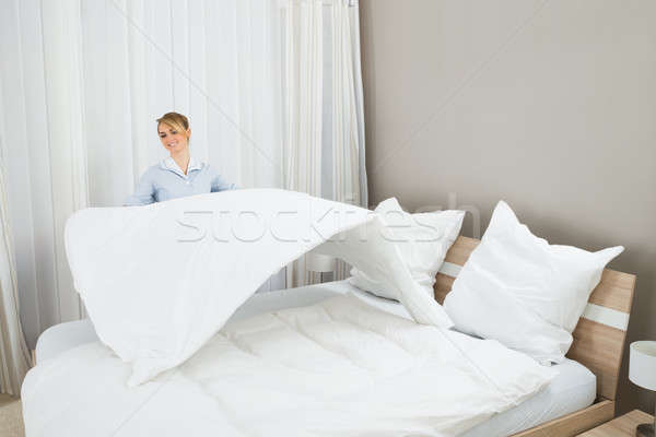 Female Housekeeping Worker Making Bed Stock photo © AndreyPopov