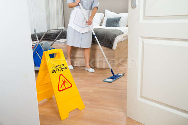 Female Maid Cleaning Floor Stock photo © AndreyPopov