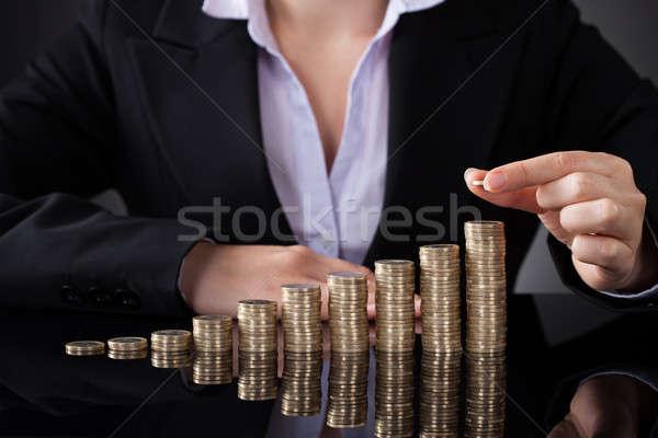 деловая женщина монетами монеты Сток-фото © AndreyPopov