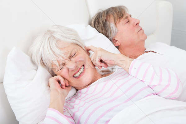 Woman Disturbed With Man Snoring Stock photo © AndreyPopov