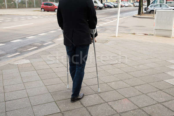 Man Walking On Street Using Crutches Stock photo © AndreyPopov