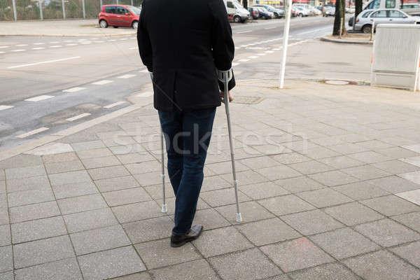 Man Walking On Street Using Crutches Stock photo © AndreyPopov
