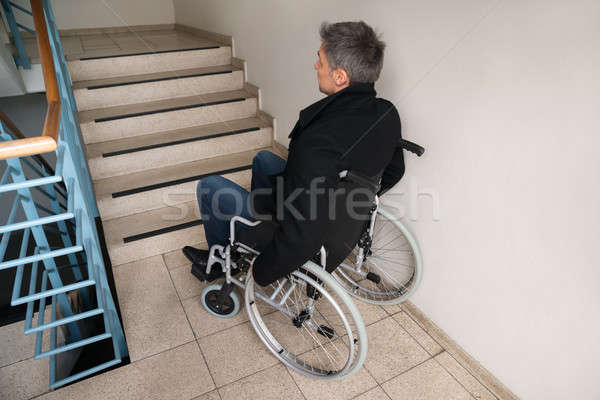 Disabled Man On Wheelchair In Front Of Staircase Stock photo © AndreyPopov