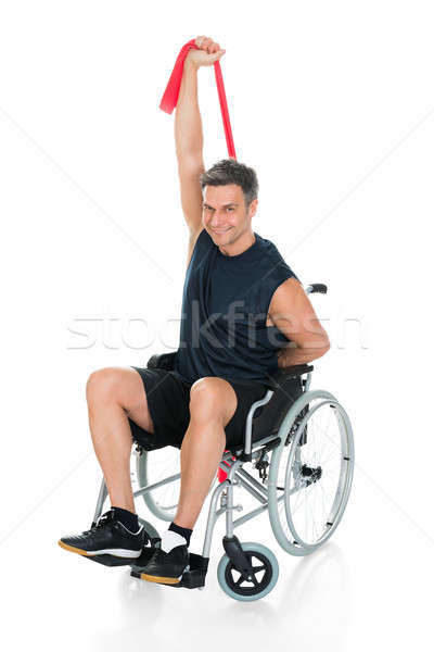 Disabled Man On Wheelchair Stretching With Resistance Band Stock photo © AndreyPopov