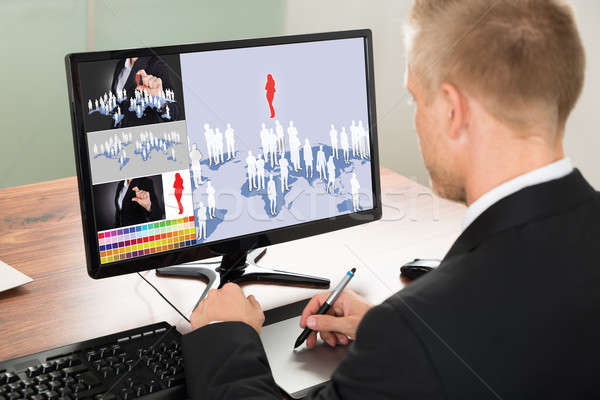 Businessman Using Graphic Tablet Stock photo © AndreyPopov