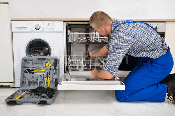 Stock photo: Man Repairing Dishwasher