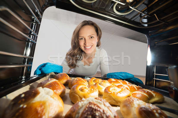 Woman Removing Bun View From Inside The Oven Stock photo © AndreyPopov
