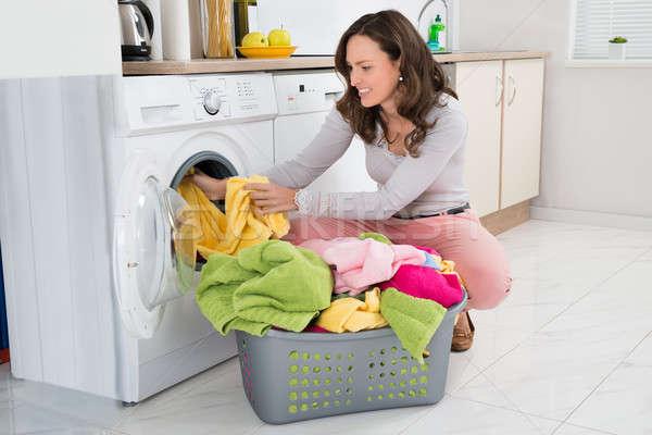 женщину одежды стиральная машина домой дома Сток-фото © AndreyPopov