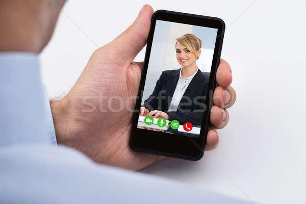 Businessperson Videochatting On Mobile Phone Stock photo © AndreyPopov