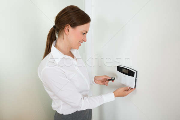 Businesswoman Operating Door Security System Stock photo © AndreyPopov