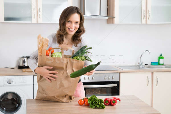 Woman Sorting Vegetables Stock photo © AndreyPopov