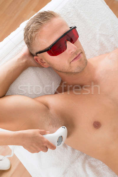 Beautician Giving Laser Epilation Treatment Stock photo © AndreyPopov