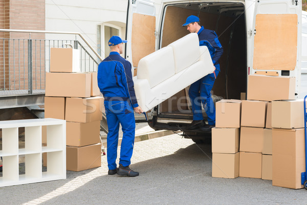 Movers Unloading Sofa From Truck Stock photo © AndreyPopov