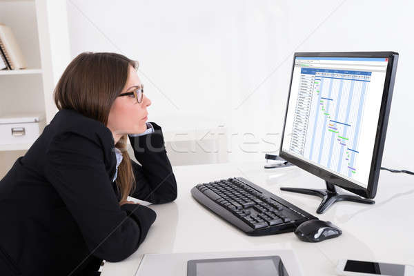 Businesswoman Looking At Gantt Chart On Computer Stock photo © AndreyPopov