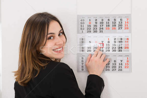 Businesswoman Looking At Calendar Stock photo © AndreyPopov