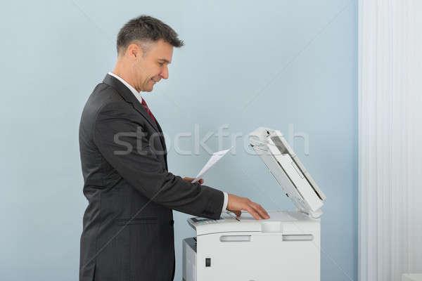üzletember gép iroda papír boldog fal Stock fotó © AndreyPopov