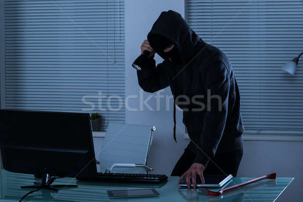 Robber With Flashlight In Office Stock photo © AndreyPopov