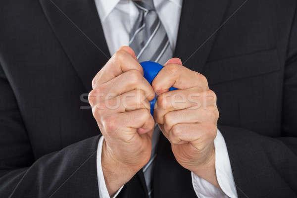 Businessman Pressing Stress Ball Stock photo © AndreyPopov