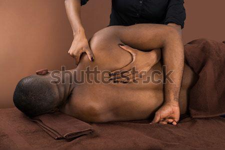 Afrika adam terapi gömleksiz genç el Stok fotoğraf © AndreyPopov