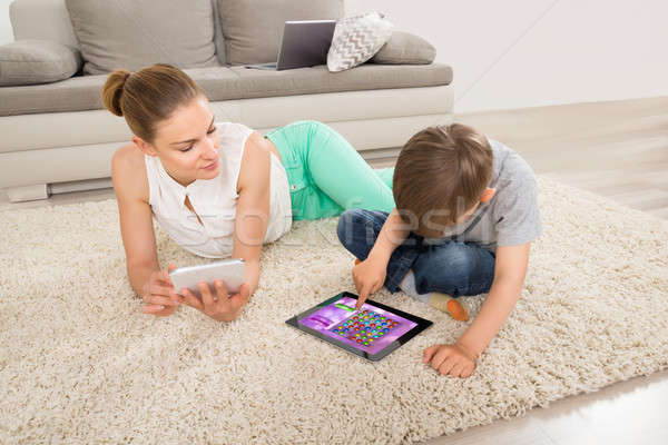 Boy Playing Game On Digital Tablet With Mother Stock photo © AndreyPopov