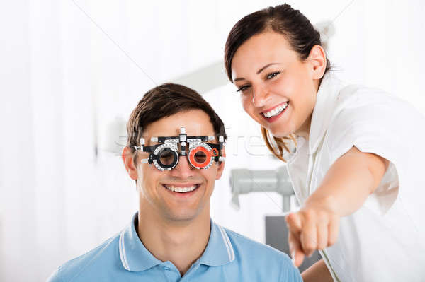 Optometrist Examining Patient's Vision With Trial Frame Stock photo © AndreyPopov