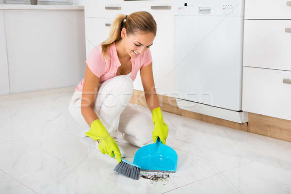 Woman Sweeping Floor With Broom And Dustpan Stock photo © AndreyPopov