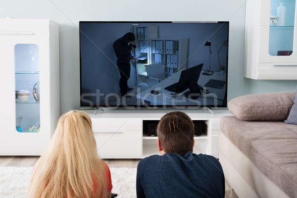 Pár néz film televízió fiatal pér szőnyeg Stock fotó © AndreyPopov