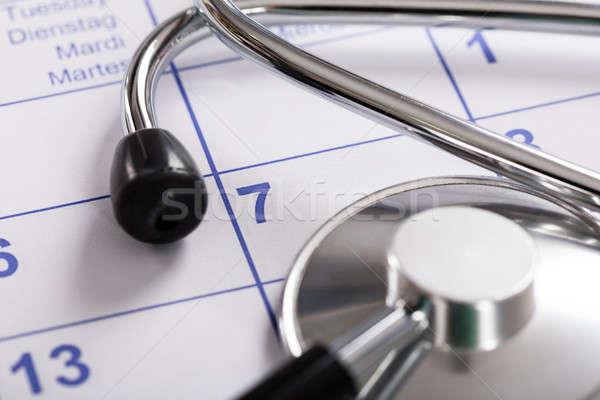 Estetoscópio calendário equipamentos médicos médico hospital Foto stock © AndreyPopov
