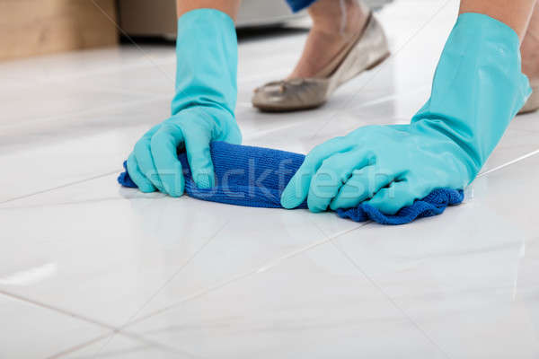 Person Cleaning Floor With Cloth Stock photo © AndreyPopov