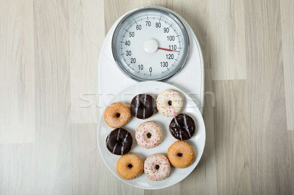 Dish Of Donuts On Weighing Scale Stock photo © AndreyPopov