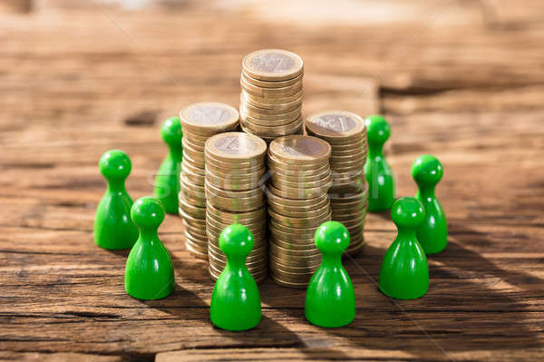 Stack Of Coins With Green Figures Stock photo © AndreyPopov