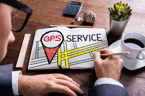 Homem desenho gps serviço bloco de notas papel Foto stock © AndreyPopov