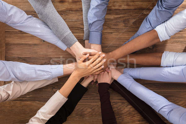Multiracial Businesspeople Stacking Their Hands Stock photo © AndreyPopov