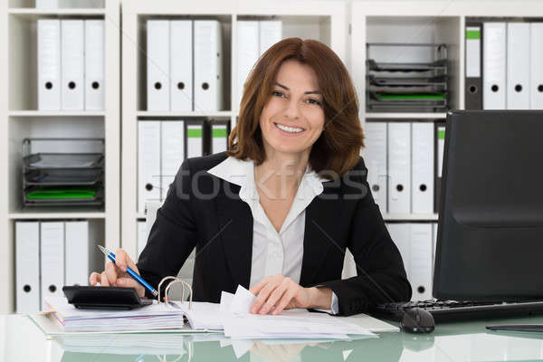 Young Accountant Woman Working In Office Stock photo © AndreyPopov
