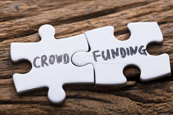 Closeup Of Connected Crowd Funding Jigsaw Pieces Stock photo © AndreyPopov