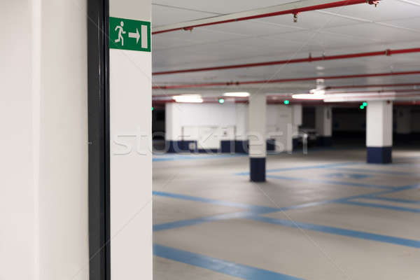 Emergency exit sign at underground parking Stock photo © AndreyPopov