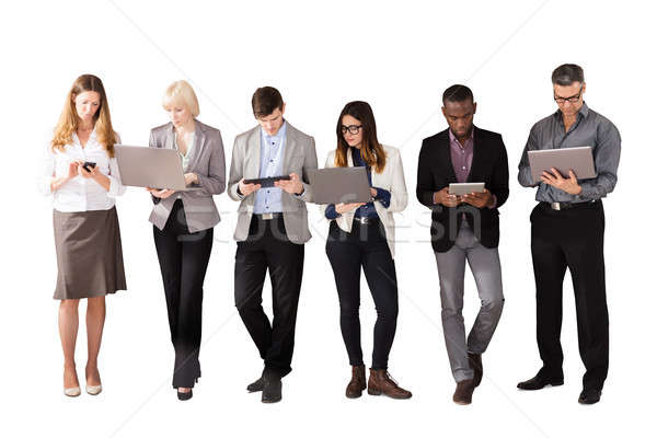 Group Of Business People Using Electronic Devices Stock photo © AndreyPopov