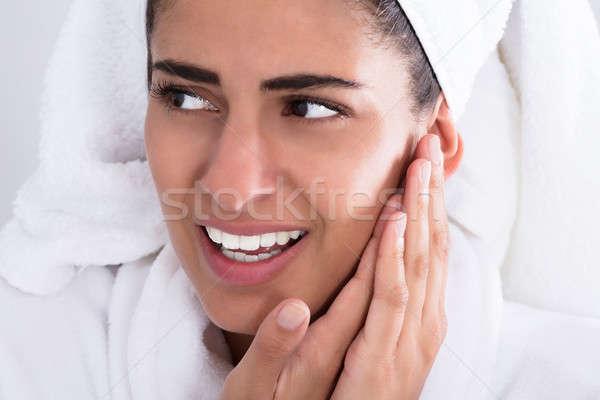 Mulher jovem dor de dente casa mão Foto stock © AndreyPopov