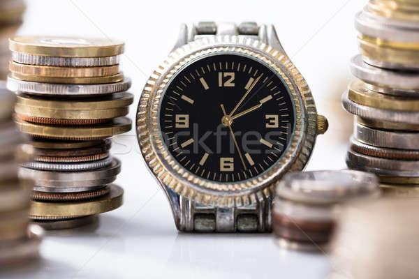 Boglya érmék karóra fehér asztal idő Stock fotó © AndreyPopov