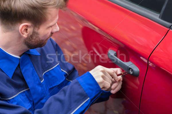 Menselijke hand opening auto deur Rood Stockfoto © AndreyPopov