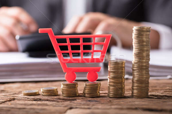 Close-up Of Shopping Cart On Stacked Golden Coins Stock photo © AndreyPopov