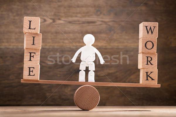 Human Figure Standing Between Work And Life Wooden Blocks Stock photo © AndreyPopov
