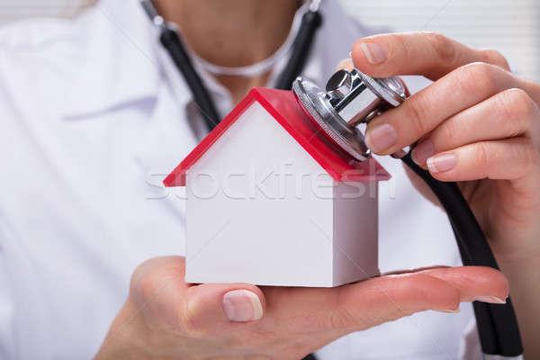Nő sztetoszkóp csekk modell ház közelkép Stock fotó © AndreyPopov