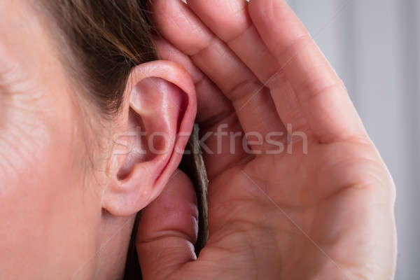 Female Hand On An Ear Stock photo © AndreyPopov