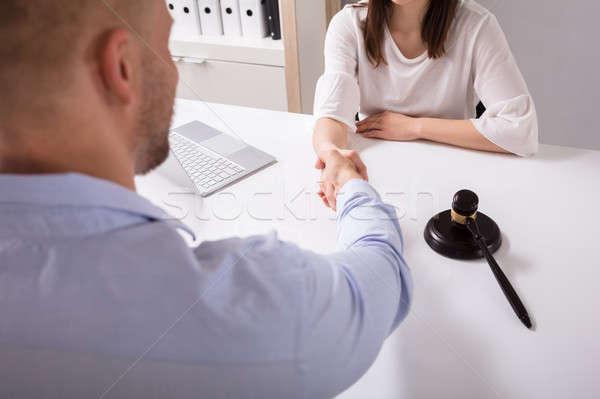 Bíró kézfogás ügyfél férfi fehér asztal Stock fotó © AndreyPopov