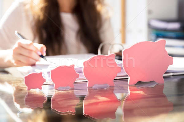 Increasing Flat Piggybank On Glass Desk Stock photo © AndreyPopov